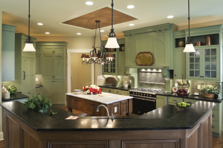 Similar to our TW-10 door design in Custom Prism paint color. Custom range hood. Inset cabinets. Island similar to our Verona Design in Cherry with Saddle Stain