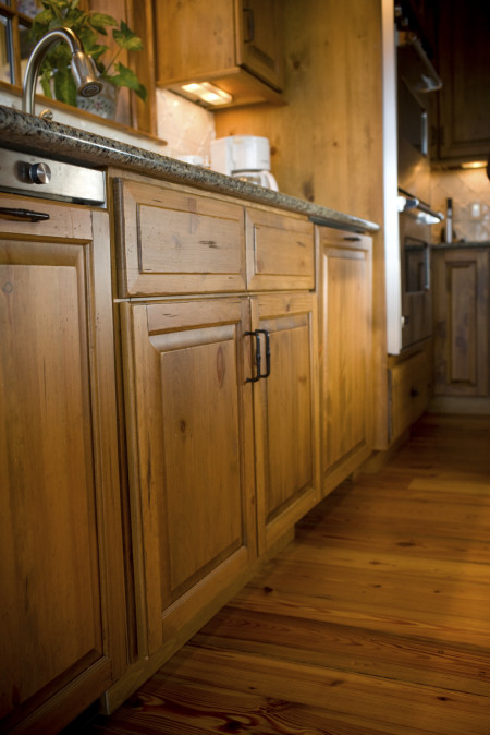Similar to our CRP-10 raised panel door with Designer Slab drawer front. Rustic Knotty Pine in Autumn Stain